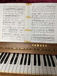 Noten auf dem Klavier, Rossini, Cruda Sorte Arie, Schluss